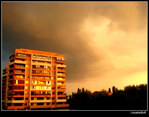 Cloudy Bucharest in summer sunset